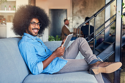 Buy stock photo Cropped portrait of a handsome young male designer working on a tablet in the office