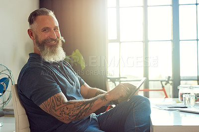 Buy stock photo Cropped portrait of a handsome mature male designer working on a tablet in his office