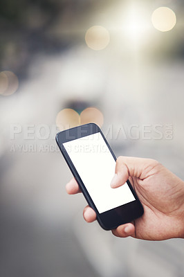 Buy stock photo Cropped shot of an unrecognizable man using a cellphone in the city