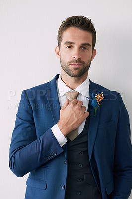 Buy stock photo Studio portrait of a handsome young groom against a gray background