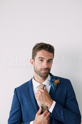Buy stock photo Studio shot of a handsome young groom against a gray background