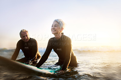 Buy stock photo Shot of a senior married couple surfing