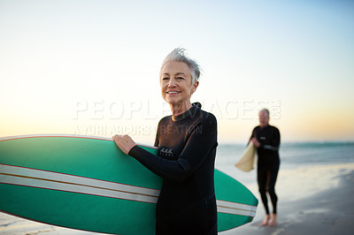 Buy stock photo Cropped shot of a senior married couple going surfing