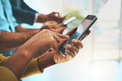 Buy stock photo Cropped shot of unrecognizable businesspeople using their cellphones in the office