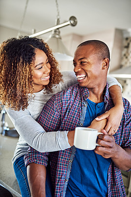 Buy stock photo Cropped shot of an affectionate young couple in their kitchen at home