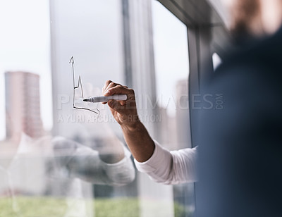 Buy stock photo Closeup shot of an unrecognizable businesswoman writing on a glass wall in an office