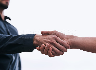 Buy stock photo Closeup shot of two unrecognizable businessmen shaking hands against a white background