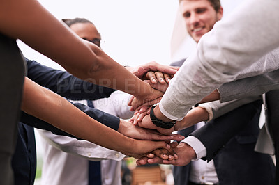 Buy stock photo Closeup shot of an unrecognizable group of businesspeople joining their hands in a huddle