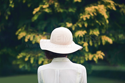 Buy stock photo Rearview shot of a woman wearing a stylish hat outdoors