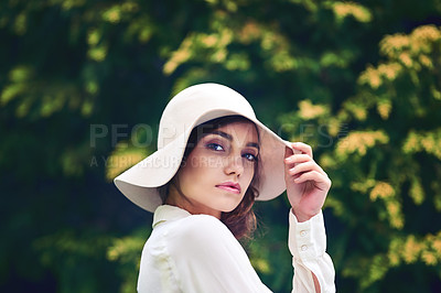 Buy stock photo Portrait of an attractive young woman wearing a stylish hat outdoors