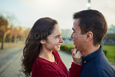 Buy stock photo Shot of a happy young couple spending a romantic day together outdoors