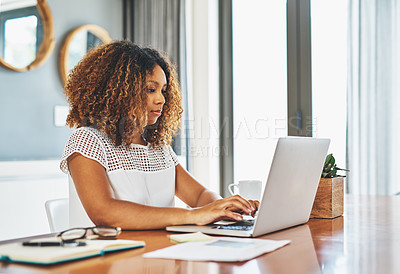 Buy stock photo Cropped shot of a young attractive businesswoman working in her office at home