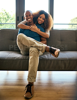 Buy stock photo Portrait of a happy young couple relaxing together at home