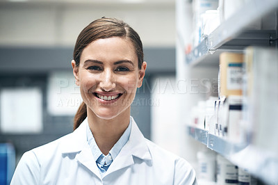 Buy stock photo Cropped portrait of a young female pharmacist working in a dispensary