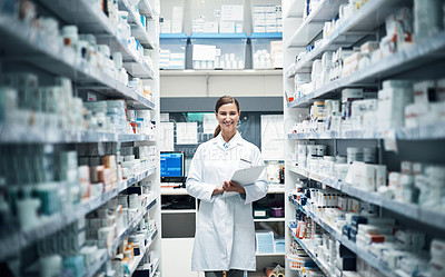 Buy stock photo Cropped portrait of a young female pharmacist doing stock take while working in a dispensary