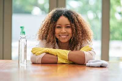 Buy stock photo Shot of a young attractive woman cleaning at home
