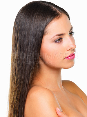 Buy stock photo Studio shot of a beautiful young woman looking thoughtful against a white background