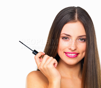 Buy stock photo Studio portrait of a beautiful young woman holding a mascara wand against a white background