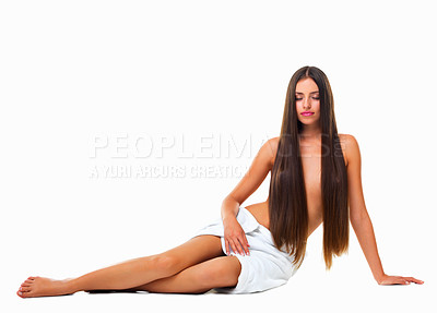 Buy stock photo Studio shot of a young woman with long hair against a white background