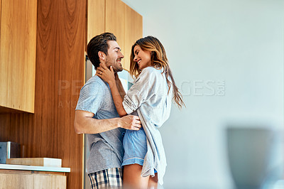 Buy stock photo Shot of an affectionate young couple bonding together at home