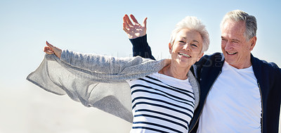 Buy stock photo Portrait of a happy senior couple having fun with their arms outstretched outdoors