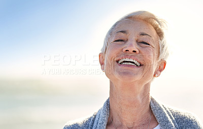 Buy stock photo Portrait of a happy senior woman spending a day at the beach