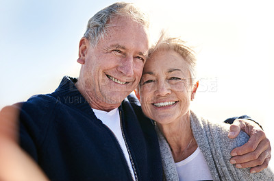 Buy stock photo Portrait of a happy senior couple taking selfies outdoors