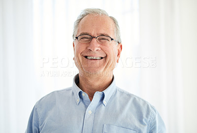 Buy stock photo Shot of a happy senior man laughing at home