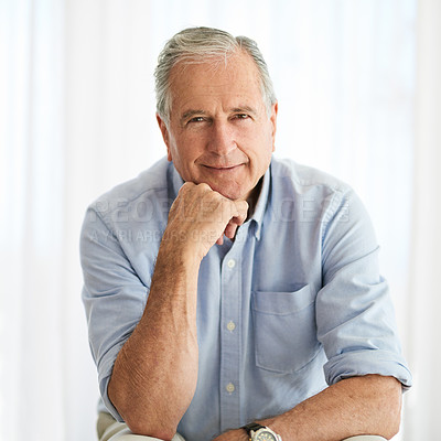 Buy stock photo Shot of a confident senior man relaxing on a chair at home