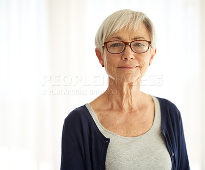 Buy stock photo Shot of a confident senior woman at home