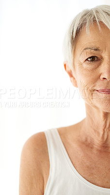 Buy stock photo Cropped shot of an attractive senior woman against a white background