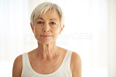 Buy stock photo Cropped shot of an attractive senior woman at home