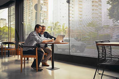 Buy stock photo Shot of businessmen working together in the office