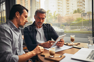 Buy stock photo Cropped shot of businessmen working together in the office