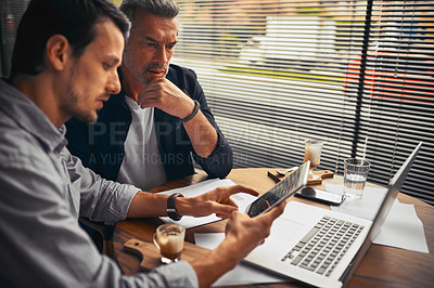 Buy stock photo Shot of businessmen working in the office