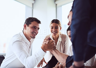 Buy stock photo Shot of two businessmen arm wrestling in an office