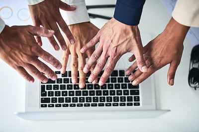 Buy stock photo Closeup shot of an unrecognizable group of businesspeople reaching towards a laptop in an office