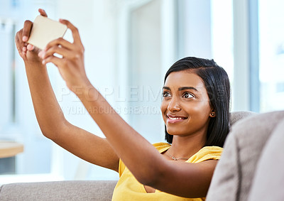 Buy stock photo Shot of a teenage girl taking a selfie at home