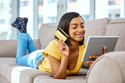 Buy stock photo Shot of a teenage girl using a tablet and credit card at home