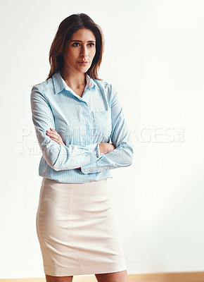 Buy stock photo Shot of a confident businesswoman in a modern office