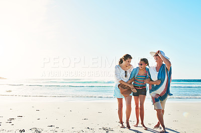 Buy stock photo Full length shot of a senior woman spending the day at the beach with her daughter and granddaughter