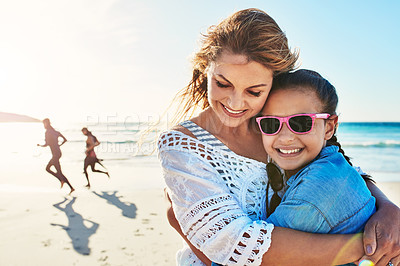 Buy stock photo Cropped shot of an attractive mature woman spending the day at the beach with her daughter