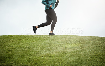 Buy stock photo Cropped shot of a woman going for a run in nature