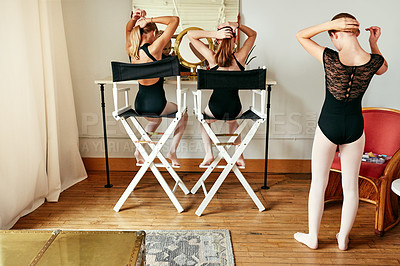 Buy stock photo Shot of a group of young girls getting ready in the dressing room of a ballet studio