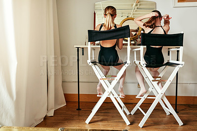 Buy stock photo Shot of  two young girls getting ready in the dressing room of a ballet studio