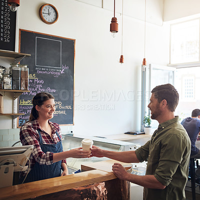 Buy stock photo Shot of a waitress serving coffee to a customer in a cafe