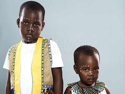 Buy stock photo Studio portrait shot of two young children standing together against a grey background