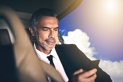 Buy stock photo Shot of a mature businessman using a mobile phone while traveling in a helicopter