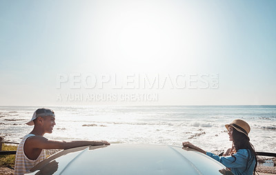 Buy stock photo Shot of a young couple enjoying a road trip along the coast