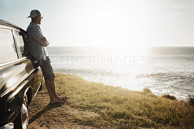 Buy stock photo Shot of a young man on a road trip along the coast